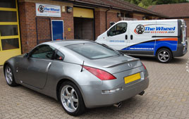 A Nissan 350Z and The Wheel Restorer van outside our premises