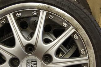 "Porsche 911 (996) 18"" splitrim showing corrosion, stone chips and dull paintwork"