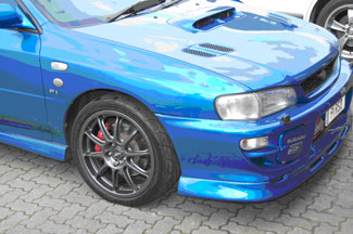 The Subaru Impreza showing the repaired and refinished wheel